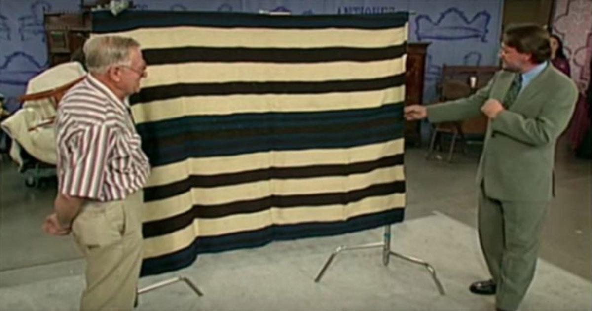 Man Brings Old Blanket On Antiques