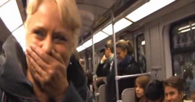 woman laughs subway