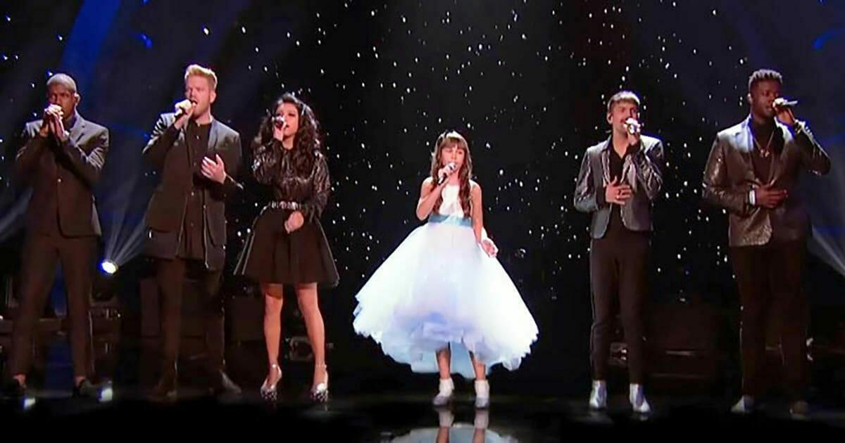 Dziewczynka cierpiąca na autyzm wystąpiła ze znaną grupą. Gdy zaczyna śpiewać, publiczność wzrusza się do łez.